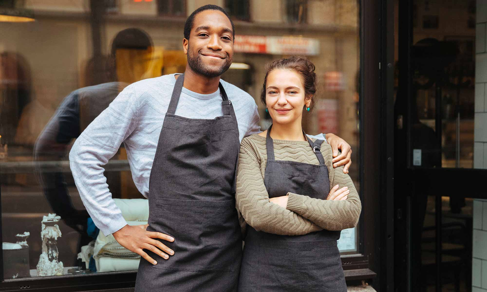Two business owners outside their coffee shop